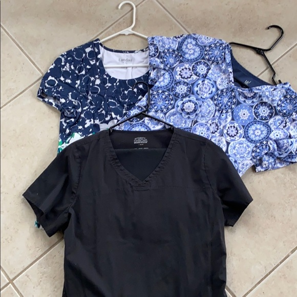 3 nursing scrub tops (Large) and 1 pants (Med).